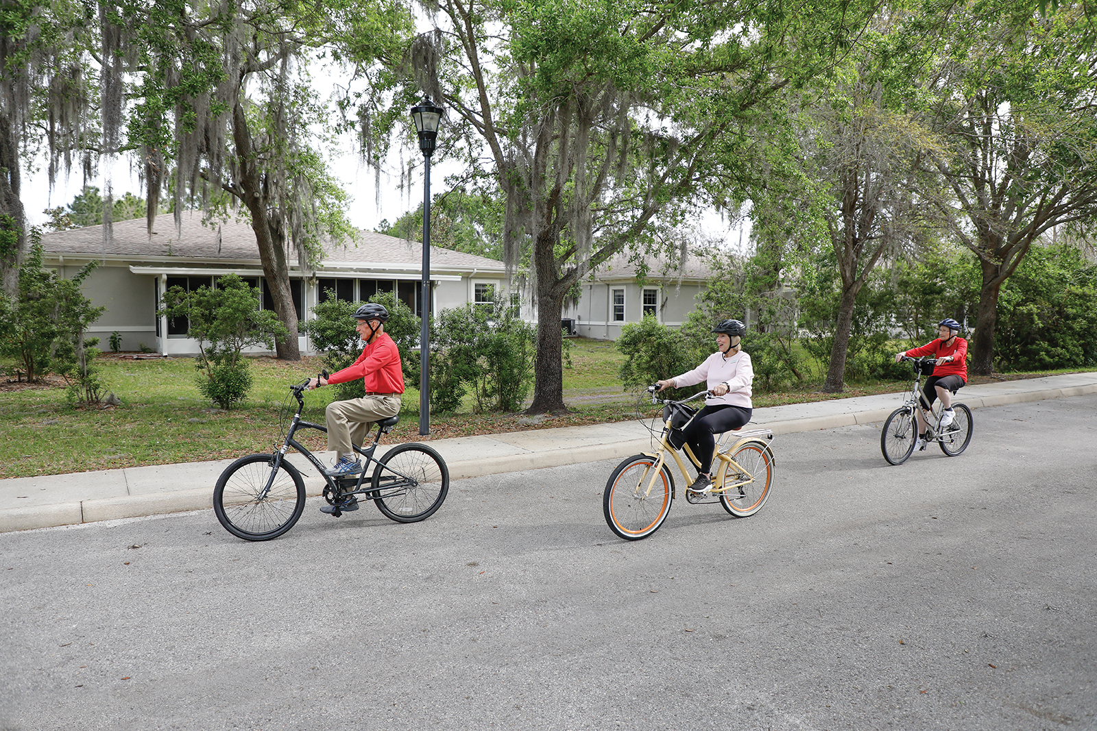 group of bikers riding by villas